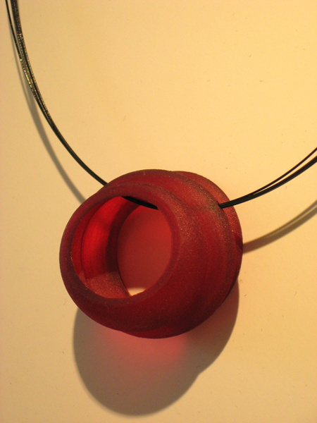 Lily Yung, Small Pendant (LY34), 2007, photosensitive resin, dyed red, 1 3/8 X 1 1/2 in.